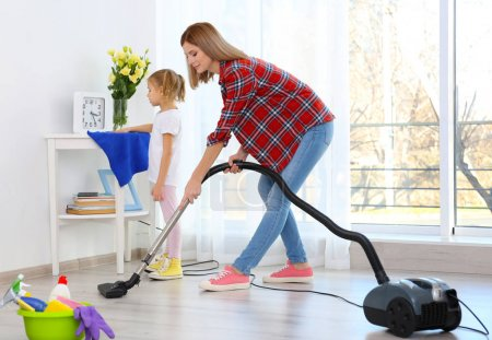 Mother and daughter doing cleanup