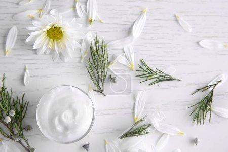Nourishing cream, thuja branches and chamomile petals o