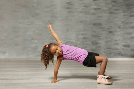 Photo for Cute African American girl in dance studio - Royalty Free Image