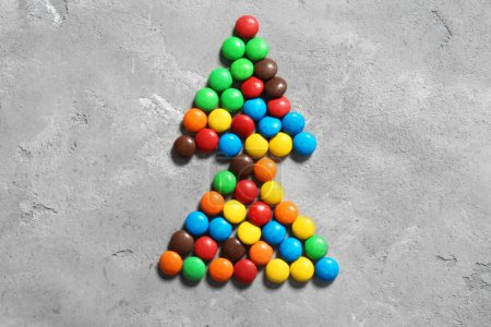 Colorful candies in shape of fir tree