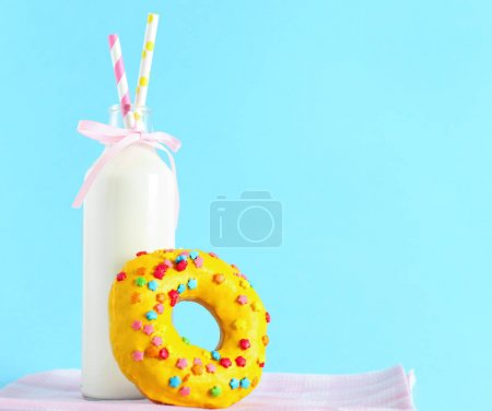 Donut and bottle of milk
