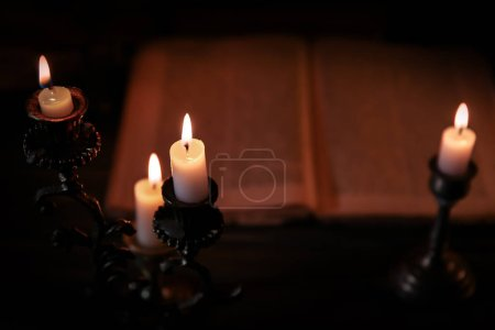 Burning candle and Bible