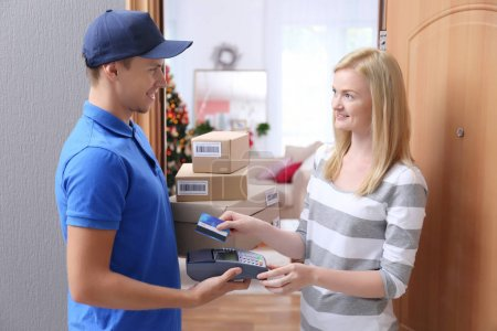 woman paying for package