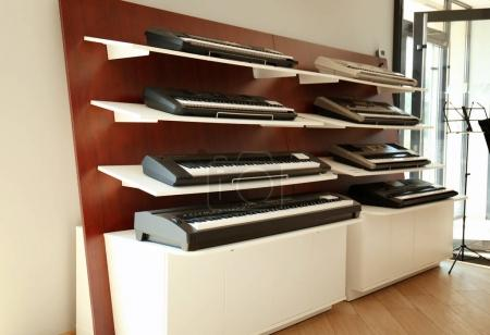 Synthesizers on shelves in shop