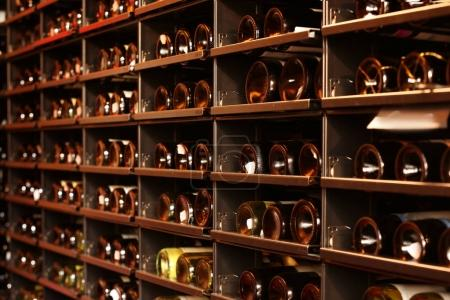 Shelving with wine bottles