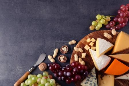 board with cheese and grape