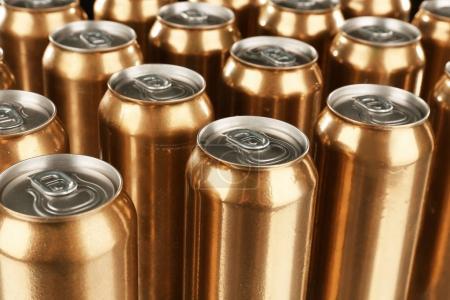 golden cans of beer