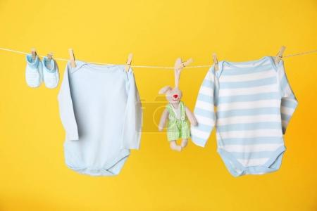 Clothesline with hanging baby clothes