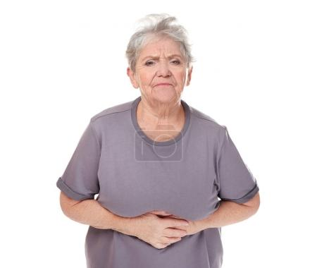 Elderly woman suffering from stomach ache