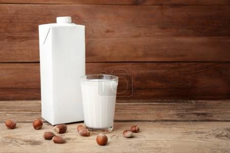Carton box and glass of milk