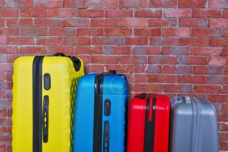 suitcases on brick background
