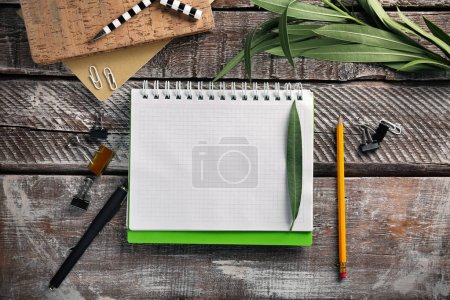 Photo for Open notebook with stationery on wooden background - Royalty Free Image