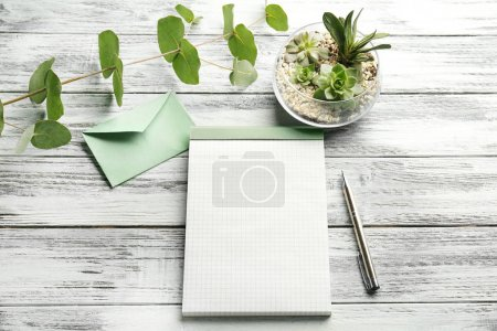 Blank notepad and succulents