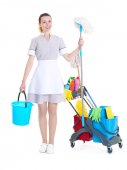 Beautiful chambermaid with cleaning equipment on white background