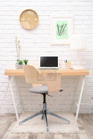 Workplace with laptop on desk