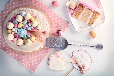 Photo for Sliced Easter cake on festive table - Royalty Free Image