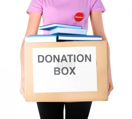 Woman holding donation box with books