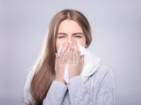 Young ill woman with tissue