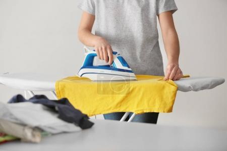 Woman ironing cloth