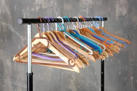 Clothes rail with wooden hangers