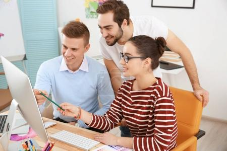 Photo for Group of young designers at workplace - Royalty Free Image