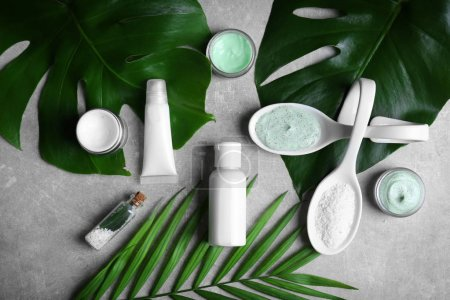 Photo for Natural cosmetics and leaves on grey background - Royalty Free Image