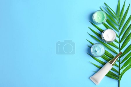 Photo for Natural cosmetics and leaf on blue background - Royalty Free Image