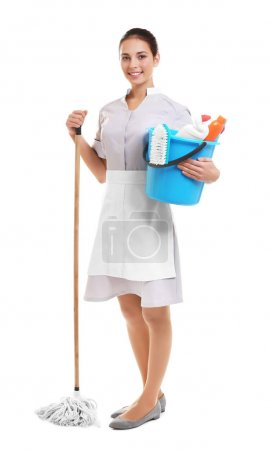 Hotel female chambermaid holding cleaning supplies...