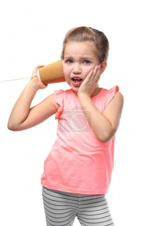 little girl using plastic cup