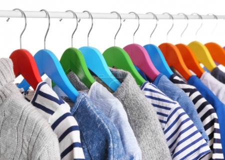 Photo for Hangers with different clothes, closeup - Royalty Free Image