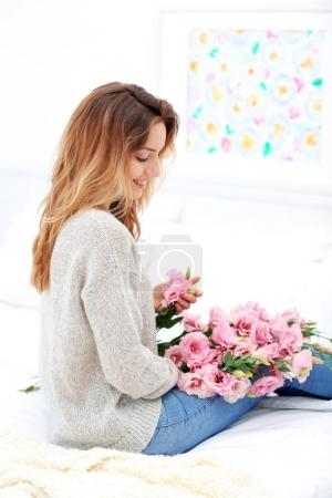 Young woman with beautiful bouquet
