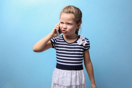 little girl talking by mobile phone