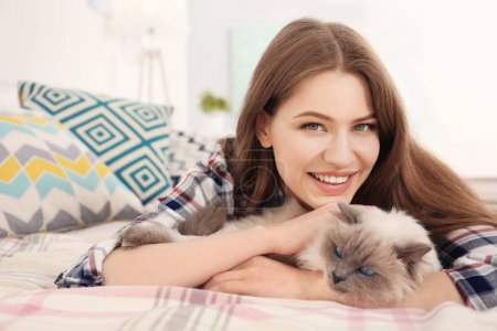 Beautiful young woman with cat