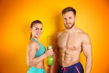 Sporty young couple training together