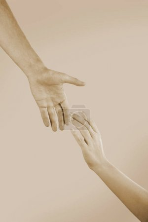 Male and female hands touching