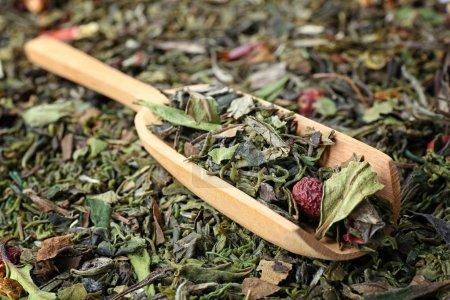 Green tea in wooden scoop