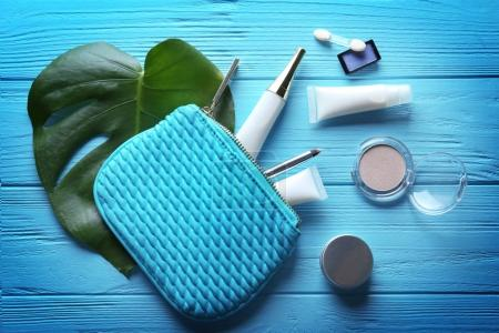 Cosmetic bag with products and leaf