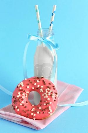 Delicious donut and bottle of milk