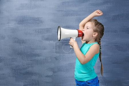 Photo for Cute little girl with megaphone on color background - Royalty Free Image