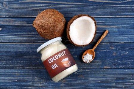 Glass jar with fresh coconut oil