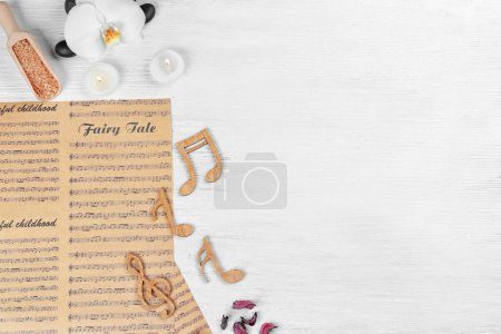 Composition of music sheets and spa supplies