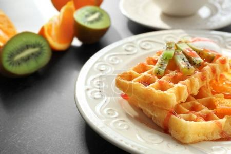 Tasty waffles with delicious fruits