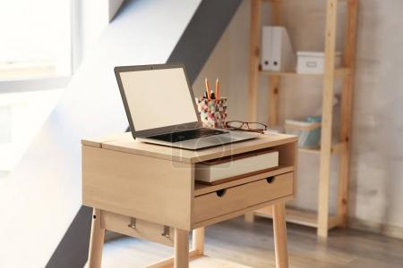 Stand-up desk with laptop