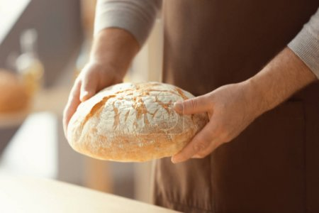 Male chef with loaf of bread