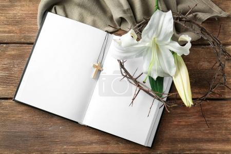 Bible, crown of thorns and white lily