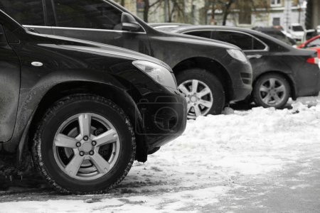 Parked cars after snowfall
