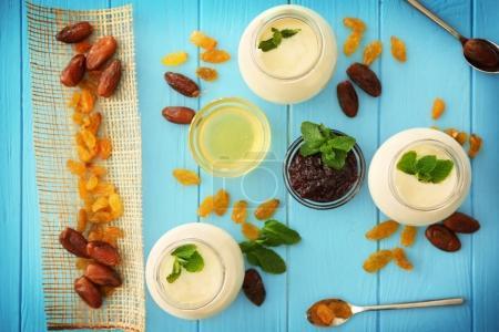 Glass jars with delicious yogurt