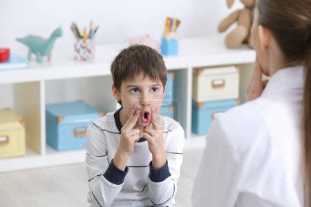 boy at speech therapist office