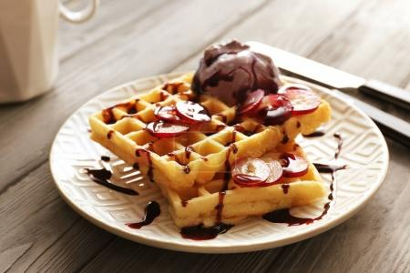 Tasty waffles with delicious grape