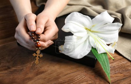 Female hands holding rosary